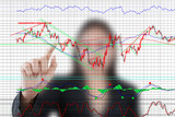 Business lady pushing finance graph for trade stock market.