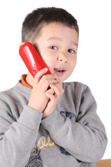 Child is talking with telephone