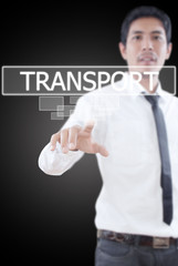 Businessman pushing Transport word on a touch screen interface.