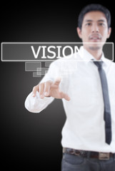 Businessman pushing Vision word on a touch screen interface.