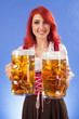 Oktoberfest girl serving beer
