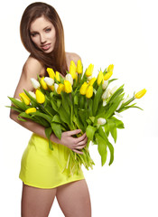 Happy woman with yellow tulips isolated on white background