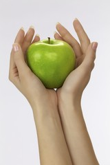 Female hands with an apple