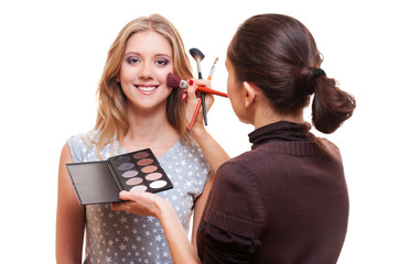 professional make-up artist working with model
