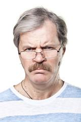 sullen caucasian mature man in glasses isolated on white
