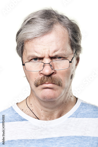 sullen caucasian mature man in glasses isolated on white