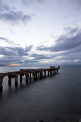 dipadated concrete pier  during sunset at lahaina, maui