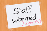Sign on the Door Saying Staff Wanted Urgently