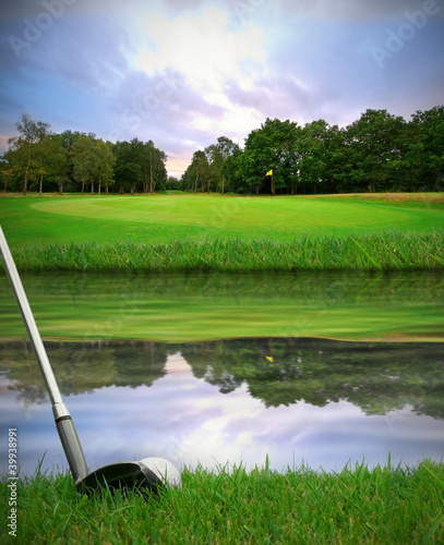hitting golf ball over water hazard