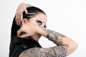 portrait of young tattooed stylish woman