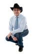 Image of a senior cowboy posing semi seated
