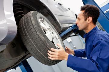 Mechanic reparing a car