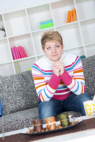 Young woman in her living room