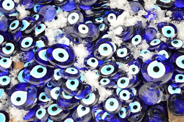 blue evil eye beads as a background