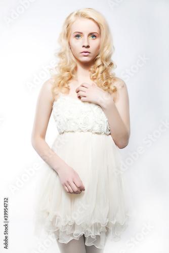 Beauty fresh blonde woman with beautiful blue eyes