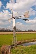 Old metal windmill and a colorful Dutch landscape
