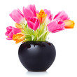 tulips in a black flower vase