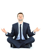businessman meditating in yoga lotus pose on floor