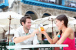 Cafe couple drinking