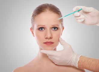 cosmetic injection of Botox on the forehead of female face