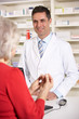 American pharmacist with senior woman in pharmacy