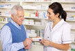 American pharmacist serving  senior man in pharmacy