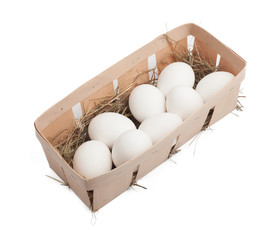 White eggs in box isolated on white