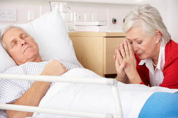 Senior woman with seriously ill husband in hospital