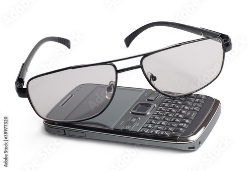 Glasses and mobile phone isolated on white