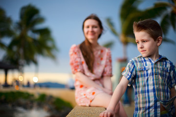 Mother and son enjoying sunset