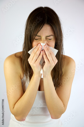 Very sick girl sneezing