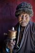 Leinwanddruck Bild - Budhist Monk swinging prayer wheel