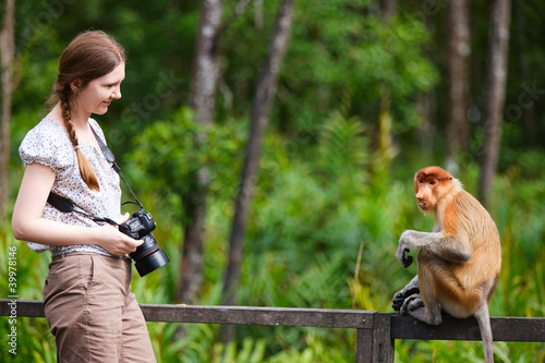 Female photographer and proboscis monkey