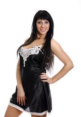 Female posing in black nightie. Isolated on white.