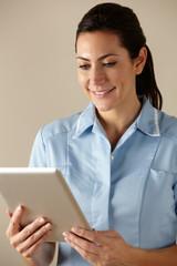 UK nurse using computer tablet