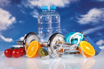 fitness barbell water and fruits