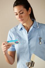 UK nurse holding prescription drug pack