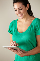 Woman using tablet studio shot