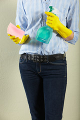 Cropped Shot Of Middle Aged Woman Holding Cleaning Products