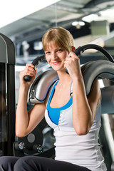 Young woman at fitness center exercise abdominal