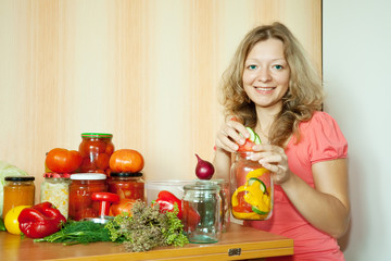 Woman making pickled vegetables