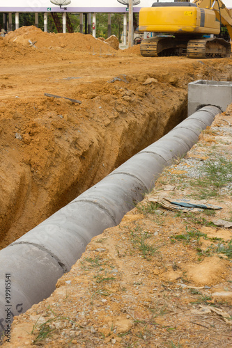 Tuinposter Kanaal Concrete drainage tank on construction site