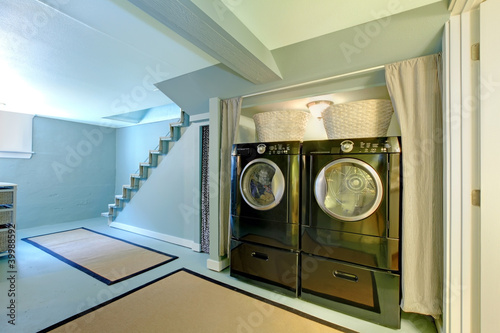 Blue basement laundry room.