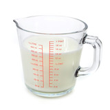 Milk in measuring cup