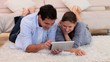 Couple using an tablet PC