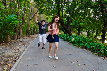 A psycho guy is chasing a cute Thai girl in the wood