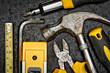 Tools kit on a metallic background