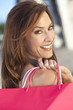 Beautiful Happy Woman With Pink Shopping Bag