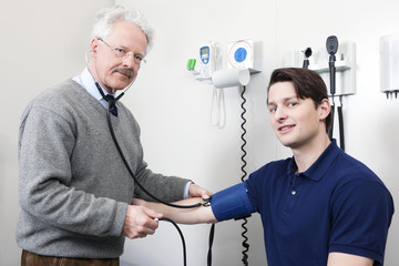 Doctor Reading Pulse Rate Of a Patient