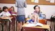 Peaceful teacher handing out sheets